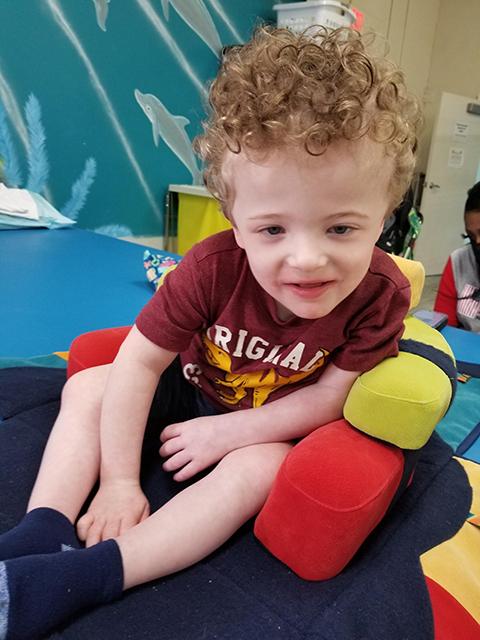 Mason with a Firefly Playpak